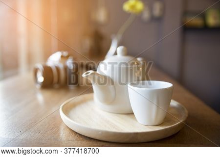 Coffee And Tea Time Concept.cup Of Coffee Or Tea ,old Dslr Camera And Teapot On Wooden Table. Relaxi