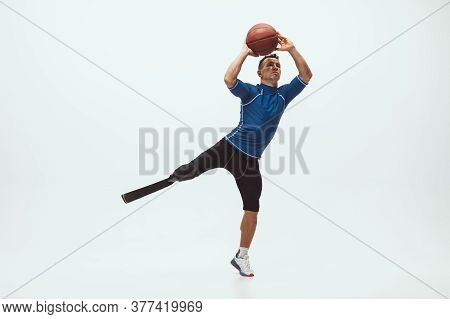 Athlete With Disabilities Or Amputee On White Studio Background. Professional Male Basketball Player