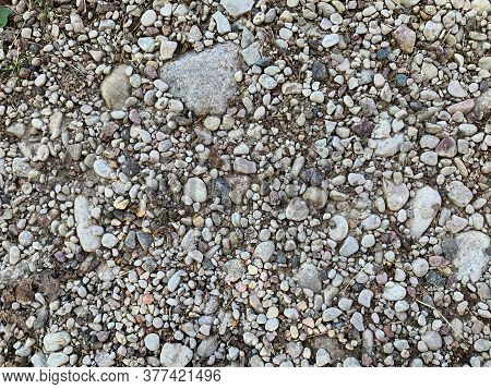 Small Sea Stones In Grey Color. Background Of Stones.