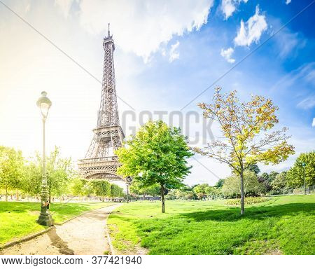 Paris Eiffel Tower With Park In Paris, France. Eiffel Tower Is One Of The Most Iconic Landmarks Of P