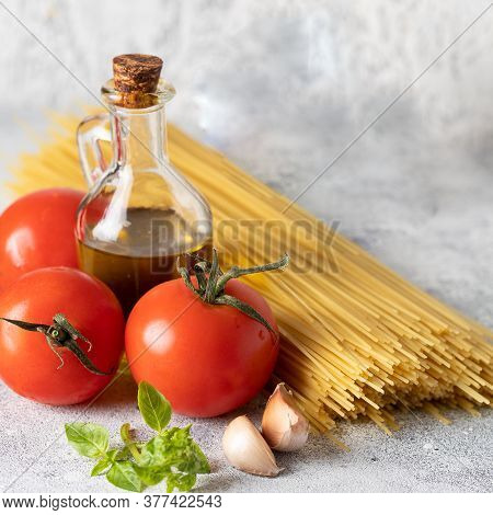 Dry Spaghetti Bunch, Fresh Tomatoes, Basil, Garlic And Olive Oil.principal Igridients For Italian Di