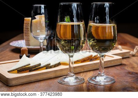 Spanish Fino Dry Sherry Wine From Andalusia And Pieces Of Different Sheep Hard Manchego Cheeses Made
