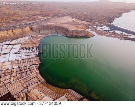 Aerial View Of Saline Pond And Salt Evaporation Ponds Filled From Ocean Salt Crystals. Salt Producti
