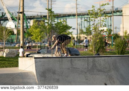 Skaters And Bikers Practice Tricks At An Outdoor Skatepark During The Corona Virus In Detroit