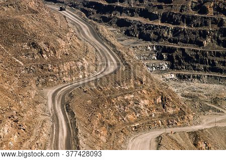 An Iron Ore Quarry, A Road Of Stepped Terraced Relief, Mining Industry. Mine And Quarry Equipment.