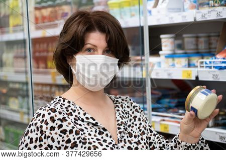 Portrait Of A Woman In A Medical Mask Chooses Products In The Store