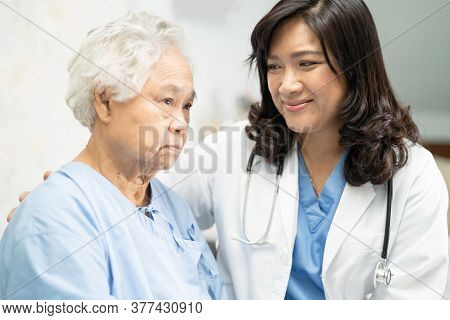 Doctor Touching Asian Senior Or Elderly Old Lady Woman Patient With Love, Care, Encourage And Empath