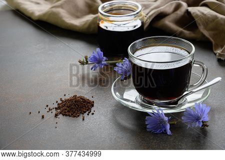 Chicory Beverage In Glass Cup, Concentrate And Flowers. Healthy Herbal Beverage, Coffee Substitute.