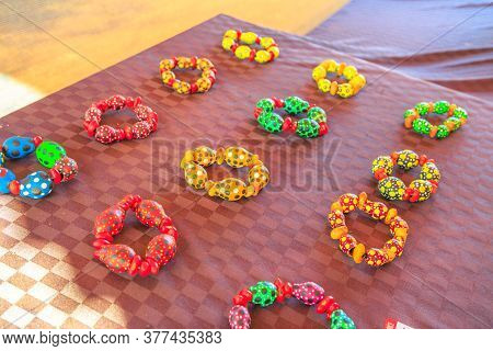 Kings Creek Station, Northern Territory, Australia - Aug 21, 2019: Native Australians Bracelets Made