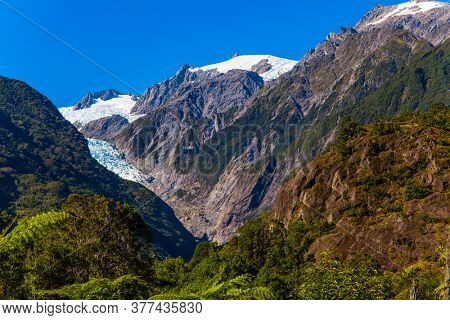 The highest peak of New Zealand Mount Cook and the Fox Glacier. Wonderful summer day. South Island of New Zealand. The concept of active and photo tourism