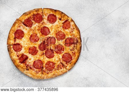 Pepperoni Pizza On White Concrete Background. Top View With Copy Space. Tasty Sliced Pepperoni Pizza