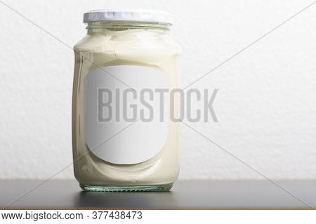 Whey Glassy Jar With Round Cap On Black Table, Editable Mock-up Series Template Ready For Your Desig