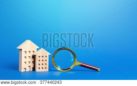 Residential Buildings And Magnifying Glass. Search For Real Estate To Buy. Long-term And Short-term