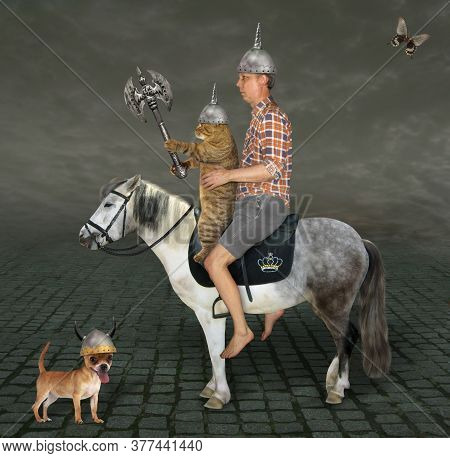 The Beige Cat Warrior With A Double Headed Battle Axe And A Man Are Riding A Gray Horse Along A Cobb