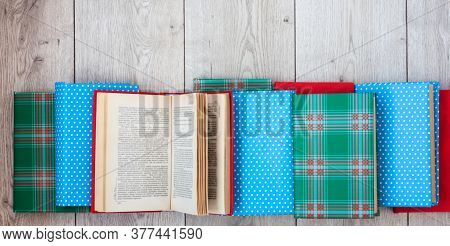 Back To School, Pile Of Books In Colorful Covers On Wooden Table Background. Distance Home Education