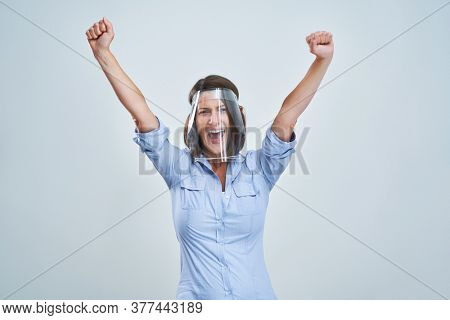 Attractive woman wearing protective shield thinking over white background