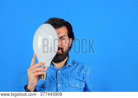 Idea. Serious Man Thinking. Good Idea. Birth Of Ideas. Man With Lamp. Bearded Man Thinking. Energy A