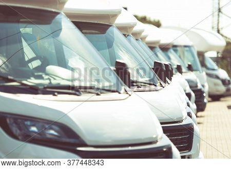 Line Of Brand New Camper Vans Motorhomes Awaiting Clients On Dealership Sales Lot. Recreational Vehi