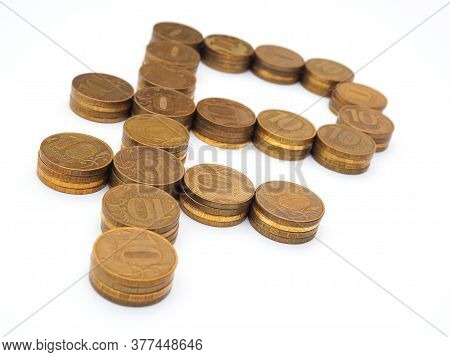 The Sign Of The Russian Ruble, Lined With Piles Of 10-ruble Coins. National Currency And Economy Of