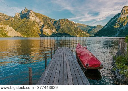 Wooden Deck, Rocky Cliffs, Lush Mountains And Quaint Villages Surround This Sprawling, Deep Water Tr