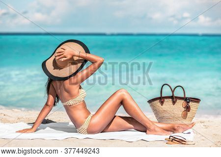Beach body summer bikini woman sun tanning with sexy slim legs and stomach for weight loss non surgical cosmetic treatment. Hair removal, smooth skin.