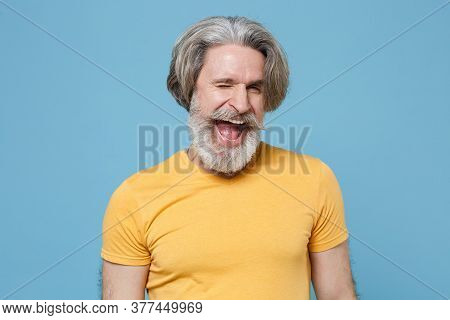 Cheerful Funny Elderly Gray-haired Mustache Bearded Man In Casual Yellow T-shirt Posing Isolated On