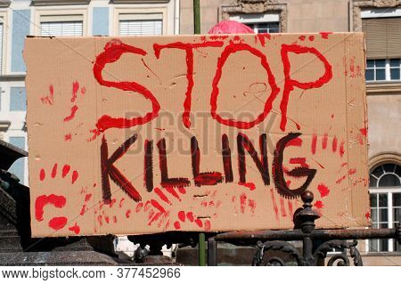 Stop Killing Sign At A Rally, Peace Movement On A Demonstration