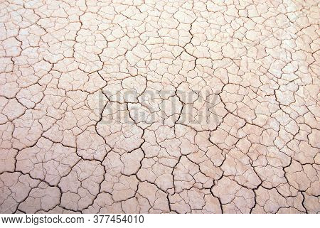 Dried Out Soil In Heat And Dryness In Summer Time