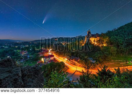 Comet In Night Starry Sky Over Bran Town And Medieval Castle. Bran Castle Is Known For The Myth Of C