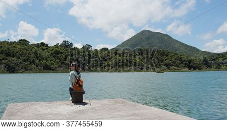 Woman enjoy sea and mountain view