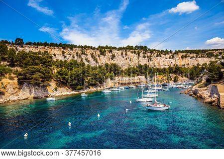 France. Picturesque bays of the Cote d'Azur. Calanques are the attractions of Provence. Sailing yachts on the azure water of the south fjord. The concept of eco-friendly and photo tourism