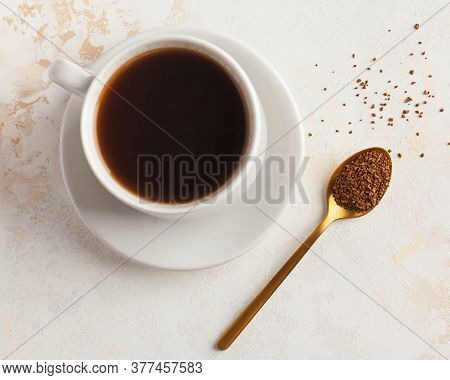 Instant Coffee In A Golden Spoon And A Mug Of Black Coffee. Concept Of Instant Coffee Birthday Celeb