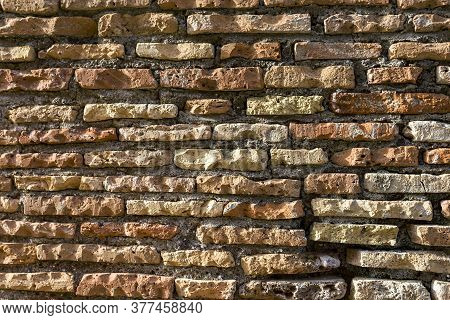 Old Brickwork. Antique Masonry. Weathered Wall, A Binding Solution Is Visible. Background Texture Pa