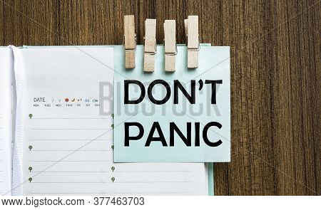 Don T Not Panic Notes Paper And A Clothes Pegs On Wooden Background
