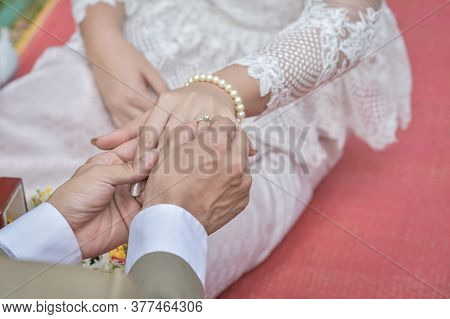 Wedding Ring.groom Put The Wedding Ring On Bride.thai Traditional Wedding Ceramony Decoration
