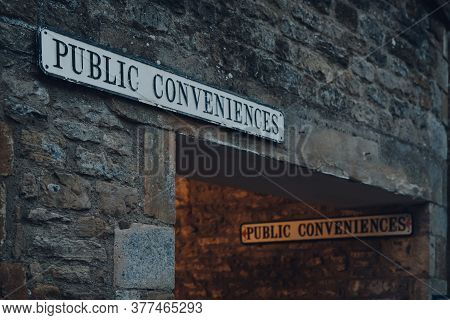 Close Up Of A Public Conveniences (toilet) Signs On A Limestone Building In Stow On The Wold, Cotswo