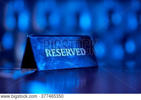 Reserved Plate On Night Club, Reserved Sign. Blue Light.
