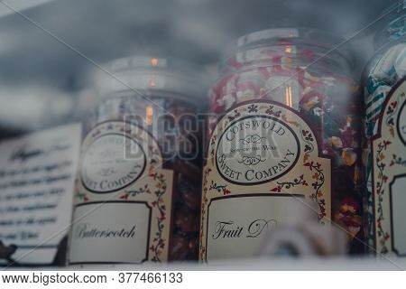 Stow-on-the-wold, Uk - July 6, 2020: Retro Sweets In Jars On Display In Shop Window In Cotswolds, An