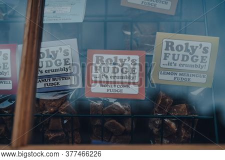 Stow-on-the-wold, Uk - July 6, 2020: Rolys Fudge On Display In Shop Window In Cotswolds, An Area In