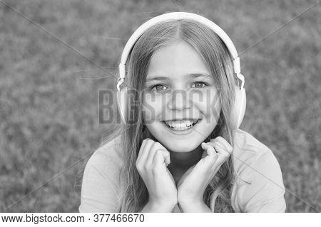 Listening Good Stories. Self Education. Headphones With Wireless Technology. Small Child Listening T