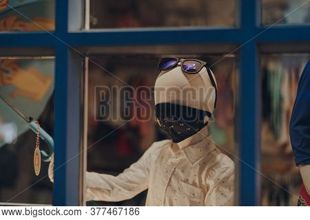 Stow-on-the-wold, England - July 6, 2020: View Through The Window Of Mannequins On Shop Display Wear
