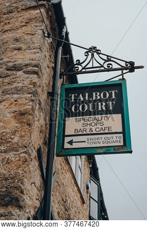 Stow-on-the-wold, Uk - July 6, 2020: Directional Sign To Talbot Court, And Area With Shops And Cafes