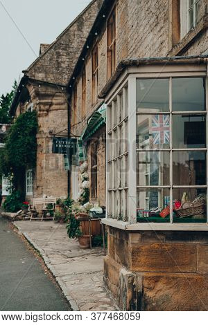 Stow-on-the-wold, Uk - July 6, 2020: Union Jack Flag On Window Display Of Organic Shop In Stow-on-th