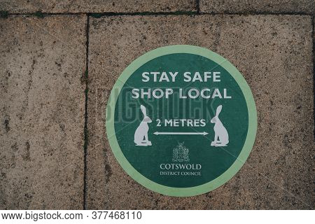 Stow-on-the-wold, Uk - July 6, 2020: Stay Safe Shop Local And 2 Metres Social Distancing Green Sign