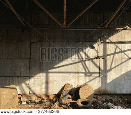 Old abandoned warehouse, view of the wall with garbage