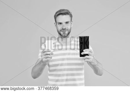 Online Shopping. Modern Phone. Handsome Well Groomed Man Creating Content For Blog. Mobile Banking.