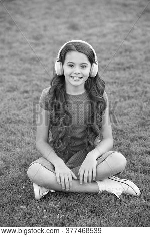 Educational Podcast. Kid Girl Enjoy Music Green Grass Meadow. Pleasant Time. Child Headphones Listen
