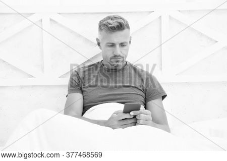 Self Isolation And Quarantine. Stay Home. Morning. Online Communication. Mature Man Use Mobile Phone