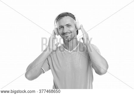 Guy In Cap Listen Music Stereo Headphones. Instrumental Music. Man Headphones White Background. Good