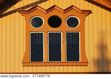 Fine Wooden Attic Decorated With Round Windows